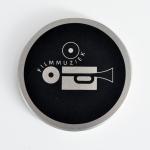 Een filmblik met een cd vol filmmuziek