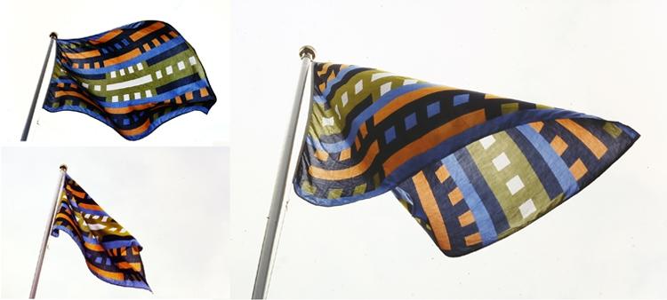 Drie wapperende vlaggen
